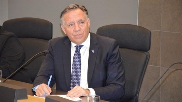 Québec crée un programme d'aide temporaire aux travailleurs touchés par le coronavirus